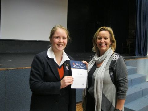 Nikki Goddard receives her Pride of Fahan Alumni Award from FSAA President, Ms Kathryn Thomas